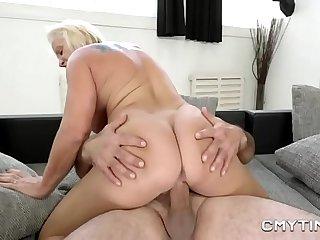 Horny granny enjoys fucking with a big cock